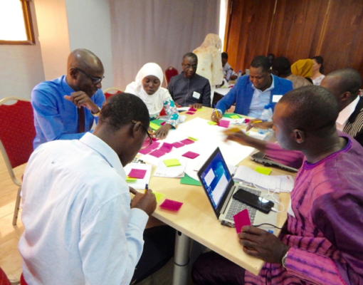 ProGREEN assessment team members write their expectations and questions for the first assessment team meeting in Dakar, Senegal 2019. Photo Credit: Mary Thompson-Hall